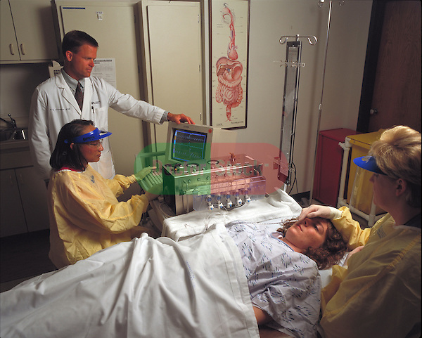 doctors performing an Endoscopic Retrograde Cholangio Pancreatography on patient