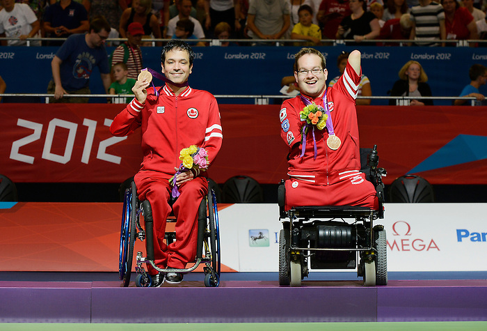 LONDON, ENGLAND 09/04/2012  Marco Dispaltro and Josh Vander Vies receiving the Bronze Medal in the Boccia Mixed Pairs - BC4 at the London 2012 Paralympic Games at Excel.  (Photo by Matthew Murnaghan/Canadian Paralympic Committee)