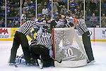February 20, 2016 - Colorado Springs, Colorado, U.S. -   Atlantic Hockey Association officials work to sort out a pile up in the Colonial goal during an NCAA ice hockey game between the Robert Morris University Colonials and the Air Force Academy Falcons at Cadet Ice Arena, United States Air Force Academy, Colorado Springs, Colorado.  Air Force defeats Robert Morris 4-1
