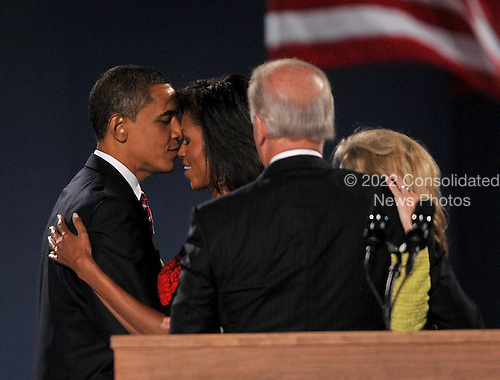 Chicago, IL - November 4, 2008 -- United States President-elect Barak Obama shares a moment with his wife, Michelle, as Vice President-elect Joseph Biden and his wife, Jill look on after Obama finished speaking in Lower Hutchinson Field, Grant Park, Chicago, Illinois after his election as President of the United States on Tuesday, November 4, 2008..Credit: Ron Sachs / CNP.(Restriction: No New York Metro or other Newspapers within a 75 mile radius of New York City)