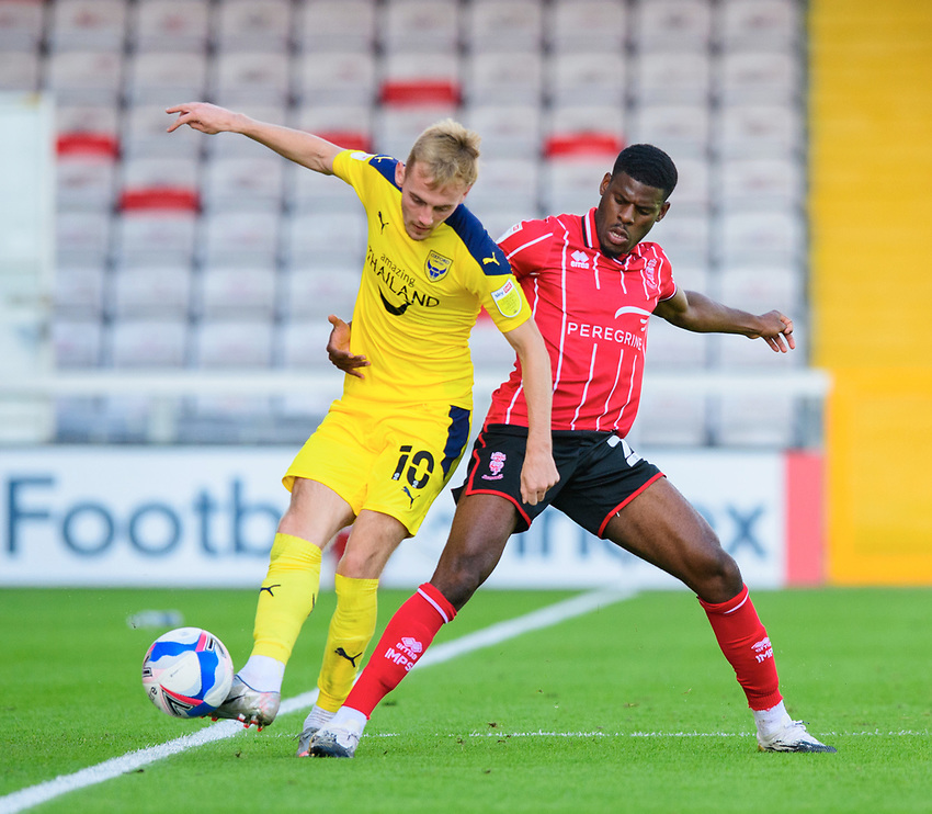 Oxford United's Mark Sykes under pressure from Lincoln City's Timothy Eyoma<br /> <br /> Photographer Chris Vaughan/CameraSport<br /> <br /> The EFL Sky Bet League One - Saturday 12th September 2020 - Lincoln City v Oxford United - LNER Stadium - Lincoln<br /> <br /> World Copyright © 2020 CameraSport. All rights reserved. 43 Linden Ave. Countesthorpe. Leicester. England. LE8 5PG - Tel: +44 (0) 116 277 4147 - admin@camerasport.com - www.camerasport.com - Lincoln City v Oxford United