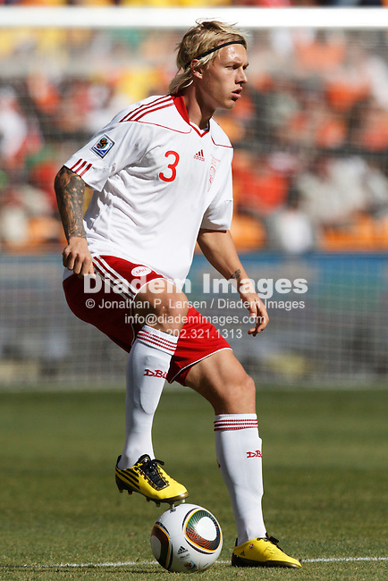 JOHANNESBURG, SOUTH AFRICA - JUNE 14:  Simon Kjaer of Denmark controls the ball during the FIFA World Cup Group E match against the Netherlands at Soccer City Stadium on June 14, 2010 in Johannesburg, South Africa.  Editorial use only.  Commercial use prohibited.  No push to mobile device usage.  (Photograph by Jonathan P. Larsen)