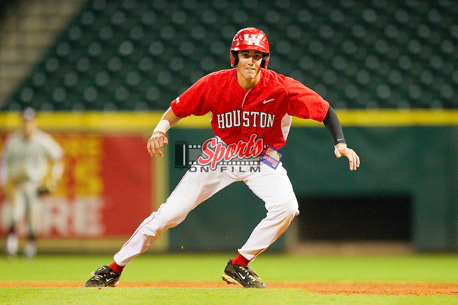 Chase Jensen #17 of the Houston Cougars takes his lead off of first base against the Texas A&M Aggies at Minute Maid Park on March 6, 2011 in Houston, Texas.  Photo by Brian Westerholt / Four Seam Images