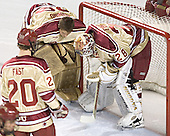 Peter Mannino and Glenn Fisher start the Denver pre-game huddle - The Princeton University Tigers defeated the University of Denver Pioneers 4-1 in their first game of the Denver Cup on Friday, December 30, 2005 at Magness Arena in Denver, CO.