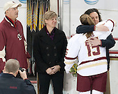 Mathew Field, Sheila Field, Emily Field (BC - 15), Courtney Kennedy (BC - Associate Head Coach) -  The Boston College Eagles defeated the visiting Boston University Terriers 5-0 on BC's senior night on Thursday, February 19, 2015, at Kelley Rink in Conte Forum in Chestnut Hill, Massachusetts.