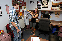 Brandon Tanner, left, of Vienna, Ill., receives a Southern Illinois University shirt from Sarita Robinson, Director of SIU Service Center - Shawnee Community College, after completing transfer paperwork in the SIU Service Center located within Shawnee Community College in Ullin, Ill., on Wednesday, July 13, 2011. Seven SIU Service Centers such as this one have partnered with Illinois state community colleges in a pilot program where students in the program will apply and be accepted at the four-year institution, but complete their first two years at the community college.