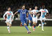 Calcio, Serie A: Napoli, stadio San Paolo, 2 aprile, 2017.<br /> Juventus Gonzalo Higuain (c) in action with Napoli's Dries Mertens (l) and Kalidou Koulibaly (r) during the Italian Serie A football match between Napoli and Juventus at San Paolo stadium, April 2, 2017<br /> UPDATE IMAGES PRESS/Isabella Bonotto