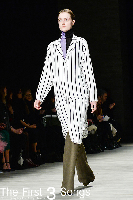 A model walks the runway at the TOME fashion show during Mercedes-Benz Fashion Week Fall 2015 at The Pavilion at Lincoln Center in New York City.