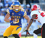 BROOKINGS, SD - OCTOBER 25:  Connor Landberg #18 from South Dakota State University eyes the defense of Dubem Nwadiobgu #22 from Youngstown State in the first quarter of their game Saturday afternoon at Coughlin Alumni Stadium in Brookings. (Photo by Dave Eggen/Inertia)