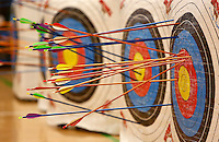 NWA Media/DAVID GOTTSCHALK - 12/17/14 - Targets are filled with arrows following an archery round by fifth grade students in the physical education class of Cheyanne (cq) Plunkett and Trey Selmon at Asbell Elementary School in Fayetteville Wednesday December 17, 2014. This is the first year for archery at the school and stresses safety, accuracy and hand eye coordination.