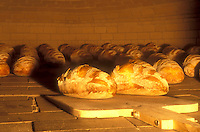 AJ5925, bread, bakery, brick oven, loaf, French bread, Loaves of freshly baked country bread are shown inside a hot brick oven at Gerard's Bakery in Westford in the state of Vermont.