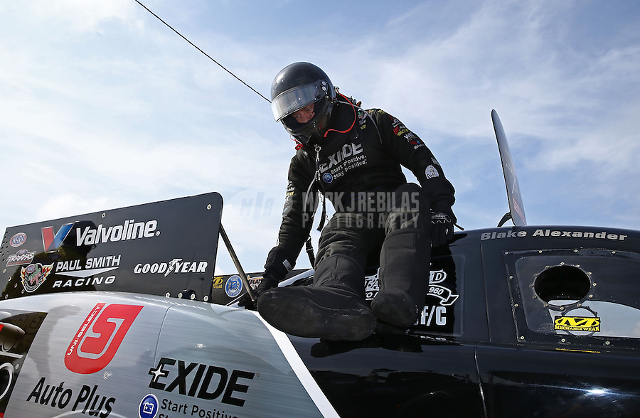 Apr. 26, 2013; Baytown, TX, USA: NHRA funny car driver Blake Alexander during qualifying for the Spring Nationals at Royal Purple Raceway. Mandatory Credit: Mark J. Rebilas-