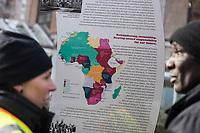 """12. Gedenkmarsch am Samstag den 24. Februar 2018 in Berlin fuer die Opfer des deutschen Kolonialismus in Afrika. Die Demonstration fand<br /> zum Jahrestag der sog. """"Berliner Afrika-Konferenz"""" 1884, in Erinnerung an die Opfer des Kolonialismus, des Sklavenhandels und der Ausbeutung Afrkias durch die Europaeischen Staaten statt.<br /> 24.2.2018, Berlin<br /> Copyright: Christian-Ditsch.de<br /> [Inhaltsveraendernde Manipulation des Fotos nur nach ausdruecklicher Genehmigung des Fotografen. Vereinbarungen ueber Abtretung von Persoenlichkeitsrechten/Model Release der abgebildeten Person/Personen liegen nicht vor. NO MODEL RELEASE! Nur fuer Redaktionelle Zwecke. Don't publish without copyright Christian-Ditsch.de, Veroeffentlichung nur mit Fotografennennung, sowie gegen Honorar, MwSt. und Beleg. Konto: I N G - D i B a, IBAN DE58500105175400192269, BIC INGDDEFFXXX, Kontakt: post@christian-ditsch.de<br /> Bei der Bearbeitung der Dateiinformationen darf die Urheberkennzeichnung in den EXIF- und  IPTC-Daten nicht entfernt werden, diese sind in digitalen Medien nach §95c UrhG rechtlich geschuetzt. Der Urhebervermerk wird gemaess §13 UrhG verlangt.]"""