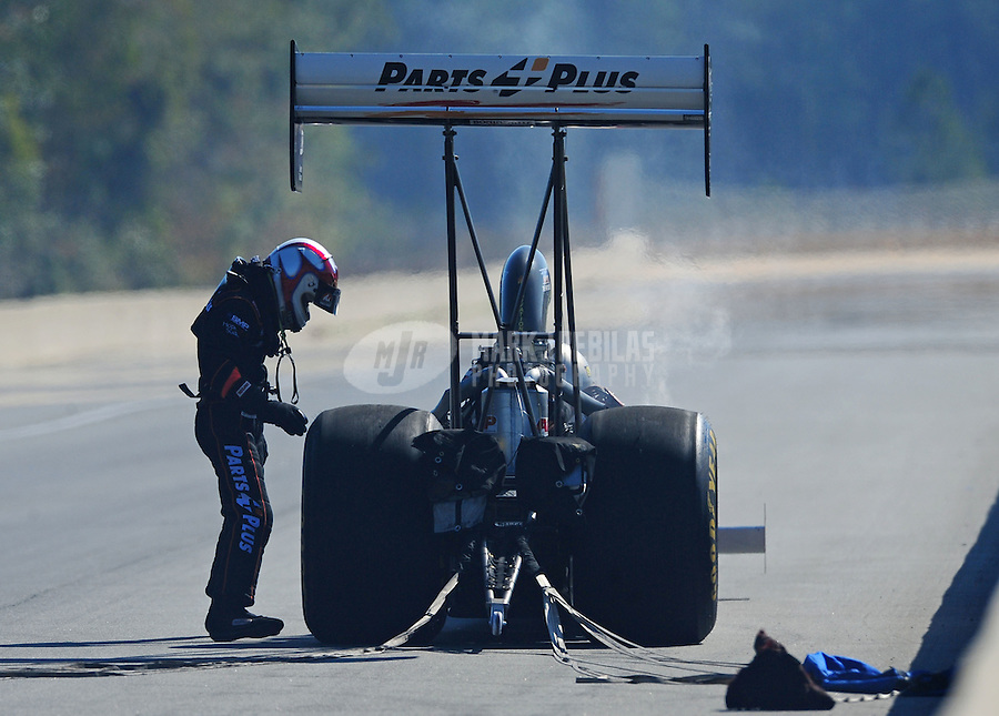 Mar. 13, 2011; Gainesville, FL, USA; NHRA top fuel dragster driver Clay Millican after losing during eliminations at the Gatornationals at Gainesville Raceway. Mandatory Credit: Mark J. Rebilas-