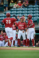 Altoona Curve first baseman Will Craig (25) is greeted by Jason Martin (23) and Ke'Bryan Hayes (10) after hitting a home run in the bottom of the fourth inning during a game against the Richmond Flying Squirrels on May 15, 2018 at Peoples Natural Gas Field in Altoona, Pennsylvania.  Altoona defeated Richmond 5-1.  (Mike Janes/Four Seam Images)
