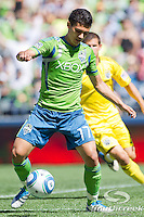 Seattle Sounders FC forward Fredy Montero (17) traps a pass upfield while competing against Columbus Crew at CenturyLink Field in Seattle, Washington. Seattle Sounders FC won the match, 6-2.