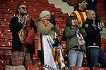 Some of the small band of around 60 visiting supporters react with delight at the Britannia Stadium, Stoke-on-Trent, after the UEFA Europa League last 32 first leg between Stoke City and visitors Valencia. The match ended in a 1-0 victory from the visitors from Spain. Mehmet Topal scored the only goal in the first half in a match watched by a crowd of 24,185.