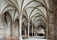 The Guest Chamber, one of the three dining halls lying one above the other at the Merveille (Marvel), 13th century, thanks to a donation by the king of France, Philip Augustus who offered Abbot Jourdain, a grant for the construction of a new Gothic-style architectural set, Le Mont Saint Michel, Manche, Basse Normandie, France. Divided down the centre by a row of columns with a double fireplace at the western end serving as a kitchen. Picture by Manuel Cohen