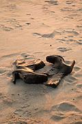 High heel boots in beach sand at Hampton Beach, New Hampshire.