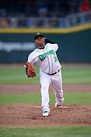Dayton Dragons starting pitcher Wennington Romero (10) delivers a pitch during a game against the Cedar Rapids Kernels on May 10, 2017 at Fifth Third Field in Dayton, Ohio.  Cedar Rapids defeated Dayton 6-5 in ten innings.  (Mike Janes/Four Seam Images)
