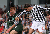 Eoin Doyle (left) and Lee Mair in the St Mirren v Hibernian Clydesdale Bank Scottish Premier League match played at St Mirren Park, Paisley on 18.8.12.