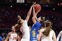 College Park, MD - March 25, 2019: Maryland Terrapins forward Shakira Austin (1) with one of her team leading six  blocks of UCLA Bruins guard Lindsey Corsaro (4) during second round game of NCAAW Tournament between UCLA and Maryland at Xfinity Center in College Park, MD. UCLA advanced to the Sweet 16 defeating Maryland 85-80.(Photo by Phil Peters/Media Images International)