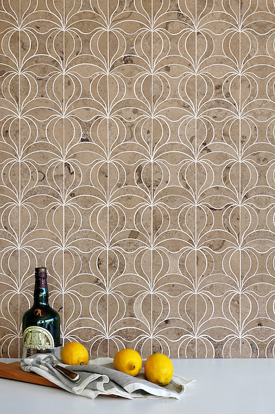 Calla, a waterjet mosaic shown in honed Jura Grey, is part of the Miraflores collection by Paul Schatz for New Ravenna.<br />