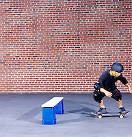 HORIZONTAL INERTIA: SKATEBOARDER JUMPS BARRIER (6 of 6)<br /> Newton's 1st Law: Moving at Constant Velocity<br /> The Skateboarder jumps straight up at the barrier.  Both boarder and board will continue to move with their original horizontal component of motion. After the barrier is passed, the boarder falls neatly back onto the board.