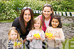 Catriona O'Callaghan and Jill Duggan pictured with Lena Duggan, Issabelle O'Callaghan and Afsa Amin at the duck race in aid of Cancer in the Demesne Killarney on Sunday. ..............