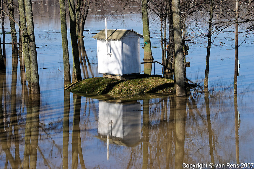 Shithouse high and dry as  an early winter flood engulfs a riverside campground.