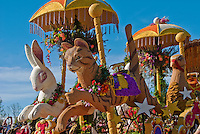 multi-colored roses, carnations, orchids, chrysanthemums, and other flowers, six ornate and oversized animals, cat,<br /> rabbit, turkey, swan, goat, and pig, designed by Raul R. Rodriguez, builder Fiesta Parade Floats
