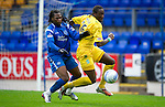 St Johnstone v Hibs...02.10.10  .Collin Samuel and Sol Bamba.Picture by Graeme Hart..Copyright Perthshire Picture Agency.Tel: 01738 623350  Mobile: 07990 594431