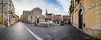 Piazza del Duomo, Taormina, panoramic photo showing the Church of San Nicola (aka the Fortress Cathedral) and the famous fountain, Sicily, Italy, Europe. This is a panoramic photo of Piazza del Duomo in Taormina showing the Church of San Nicola (aka the Fortress Cathedral) and the famous fountain, Sicily, Italy, Europe.