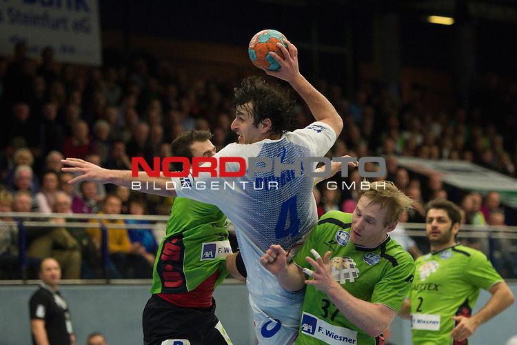 07.12.2013, Emshalle, Emsdetten,  Handball, Bundesliga, TV Emsdetten vs. HSV Handball<br /> <br /> <br /> Zweikampf zwischen Domagoj Duvnjak (#4 Hamburg) gegen Faruk Halilbegovic (#13 Emsdetten) und Ernir Arnarson (#37 Emsdetten)<br /> <br />   Foto &copy; nordphoto / Kurth