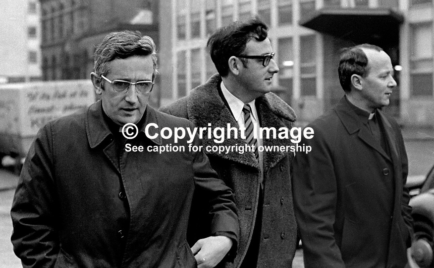 Brother Patrick Joseph Skehan, left, and Father Thomas O&rsquo;Neill, right, both with addresses at the Cistercian Monastry, Portglenone, Co Antim, arriving at a Belfast Court with their solicitor, centre, January, 1972, to face charges of aiding Belfast jail escapees. 197201000005b<br />