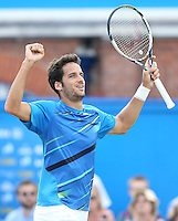 Feliciano Lopez (ESP) celebrates his victory versus Tomas Berdych (CZE) - Aegon Tennis Championships, Quarter Final at Queens Club, London - 13/06/14 - MANDATORY CREDIT: Rob Newell - Self billing applies where appropriate - 07808 022 631 - robnew1168@aol.com - NO UNPAID USE - BACS details for payment: Rob Newell A/C 11891604 Sort Code 16-60-51