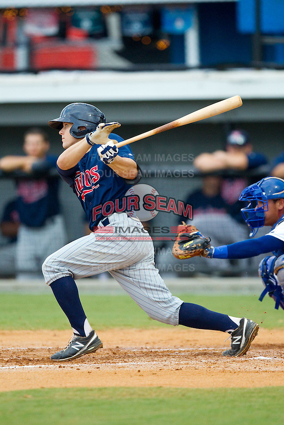 Tanner Vavra (9) of the Elizabethton Twins follows through on his swing against the Burlington Royals at Burlington Athletic Park on August 11, 2013 in Burlington, North Carolina.  The Twins defeated the Royals 12-5.  (Brian Westerholt/Four Seam Images)