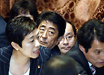 July 15, 2015, Tokyo, Japan - Japans Prime Minister Shinzo Abe, seated at center, watches opposition lawmakers make their strong protest to the chairman trying to obstruct proceedings during a vote on the government-sponsored security related bills in a Diet lower house special committee on national security in Tokyo on Wednesday, July 15, 2015. The committee voted to approve the bills with the support of the ruling Liberal Democratic Party and its junior coalition partner Komeito. The bills will be put to a vote in a Diet plenary session as early as July 16, after which it will be sent to the upper house. The bills, when enacted, will allow Japan to exercise its right to collective self-defense. (Photo by Natsuki Sakai/AFLO) AYF -mis-