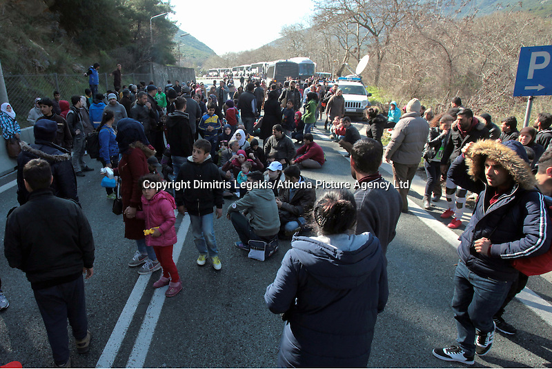 Pictured: Stranded migrants on the motorway in Tempe Thursday 25 February 2016<br /> Re: Hundreds of migrants, including families with young children, that were stranded at Tempe in central Greece, were forced to walk on foot on the motorway to reach Idomen, about 168 kilometres away, in the northern part of the country, at the Greek FYRO Macedonian border. Local police were at first escorting them, then made sure that they were safely transported on coaches.