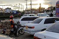 KENYA Nairobi, road construction by chines company, rush hour, traffic jam, motorcycle taxi  / KENIA Nairobi, Strassenbau durch chinesische Baufirma und Verkehrschaos, Motorrad Taxi