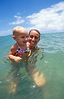Hawaii, Kauai, mother & 13 m.o. baby girl playing in sea.  MR available