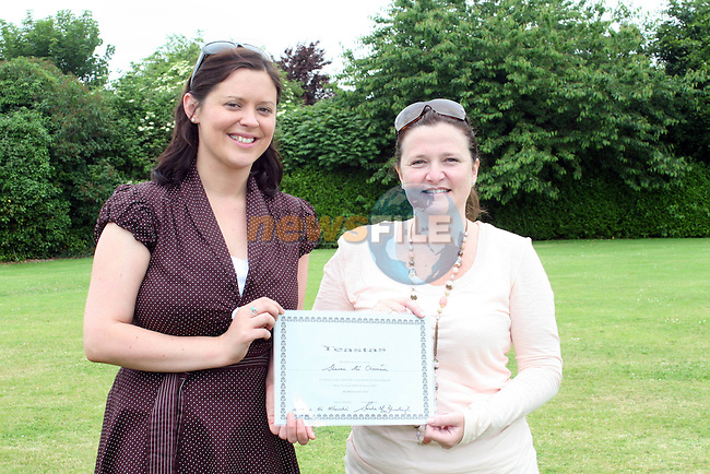 Sharon Curran receives her certificate for Irish For Parents from the HSCL Co-ordinator Sarah Bradley at the presentation of certificates to successful participants of the Home School and Community Liaison Course....Photo NEWSFILE/Jenny Matthews.(Photo credit should read Jenny Matthews/NEWSFILE)....This Picture has been sent you under the condtions enclosed by:.Newsfile Ltd..The Studio,.Millmount Abbey,.Drogheda,.Co Meath..Ireland..Tel: +353(0)41-9871240.Fax: +353(0)41-9871260.GSM: +353(0)86-2500958.email: pictures@newsfile.ie.www.newsfile.ie.FTP: 193.120.102.198.