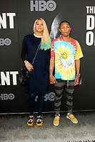 "LOS ANGELES - JUN 22:  Helen Lasichanh, Pharrell Williams at ""The Defiant Ones"" HBO Premiere Screening at the Paramount Theater on June 22, 2017 in Los Angeles, CA"