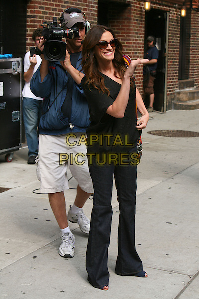"""JULIA ROBERTS .promoting her new film """"Eat Pray Love"""" on the 'Late Show with David Letterman', New York, NY, USA, August 4th, 2010..full length black top jeans denim bootcut boot cut bag  sunglasses flared flares embroidered hand cameraman camera filming top .CAP/LNC/TOM.©LNC/Capital Pictures."""