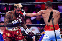 """Fairfax, VA - May 11, 2019: Julian J-Rock"""" Williams lands a left hand during Jr. Middleweight title fight against Jarrett """"Swift"""" Hurd at Eagle Bank Arena in Fairfax, VA. Julian Williams defeated Hurd to take home the IBF, WBA and IBO Championship belts by unanimous decision. (Photo by Phil Peters/Media Images International)"""