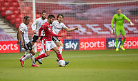 7th July 2020; City Ground, Nottinghamshire, Midlands, England; English Championship Football, Nottingham Forest versus Fulham; Tiago Silva of Notts Forest tracked by a posse of Fulham players