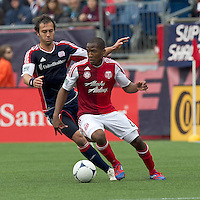 Portland Timbers forward/midfielder Darlington Nagbe (6) at midfield as New England Revolution defender AJ Soares (5) defends. In a Major League Soccer (MLS) match, the New England Revolution defeated Portland Timbers, 1-0, at Gillette Stadium on March 24, 2012