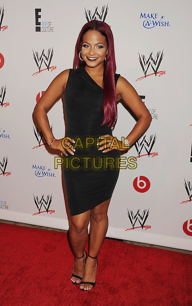 Christina Milian<br /> WWE &amp; E! Entertainment's &quot;SuperStars For Hope&quot; supporting Make-A-Wish at The Beverly Hills Hotel in Beverly Hills, CA., USA.<br /> August 15th, 2013<br /> full length dress black one shoulder hands on hips<br /> CAP/ROT/TM<br /> &copy;Tony Michaels/Roth Stock/Capital Pictures