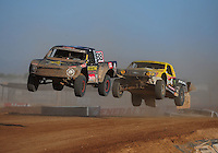 Apr 16, 2011; Surprise, AZ USA; LOORRS driver Brian Deegan (38) leads Rob Naughton (54) during round 3 at Speedworld Off Road Park. Mandatory Credit: Mark J. Rebilas-