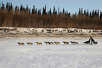 Saturday March 10, 2007   ----   Jeff King runs on the Yukon River on Saturday between Eagle Island and Kaltag in 35-45 mph wind.